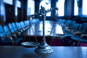 scales-of-justice-in-courtroom-1024x680